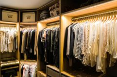 Walk in closet, dressing room. Luxurious walk in closet with lighting and jewelry display. Womans dressing room stock photos
