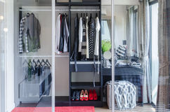 Walk in closet with glass partition in bedroom. At home royalty free stock images