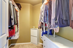 Walk in closet with organized clothing. Northwest, USA stock images