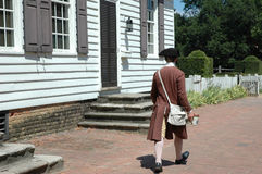 Walk through Colonial Williams. Man dressed up in a colonial outfit walking down Colonial Williamsburg, Virginia Stock Photos