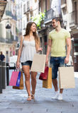Walk couple after shopping Stock Photos