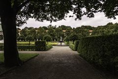 The Garden of the Court Hofgarten, Munich. A walk through the court garden Hofgarten in Munich Germany, surrounded by trees, hedges, fountains and flowers stock photography