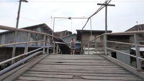 Walk in crossing the wooden bridge. Thailand