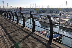 Walk deck in Brighton Marina. Boardwalk along the harbour side of Brighton Marina royalty free stock photo