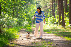 Walk with the dog. Beautiful brunette on the walk with the dog Royalty Free Stock Photography