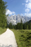 Walk in Dolomite. A beautiful pathway with Dolomite mountains in Italy during summer Stock Photography