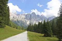 Walk in Dolomite. A beautiful pathway with Dolomite mountains in Italy during summer Royalty Free Stock Photography