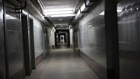 Walk down an endless hallway in a creepy. Abandoned building. hd stock footage