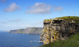 Walk on the edge of Cliffs. Cliffs of Moher - highest cliffs in Europe Stock Images