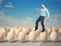 Walk on eggs Royalty Free Stock Photo