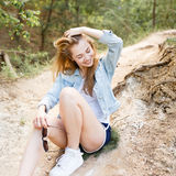 Walk emotional young girl summer day in the forest park. Hipster. Happiness and freedom outdoors. The natural beauty and emotions Royalty Free Stock Images