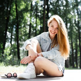 Walk emotional young girl summer day in the forest park. Hipster. Happiness and freedom outdoors. The natural beauty and emotions Stock Image