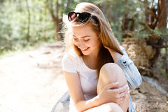 Walk emotional young girl summer day in the forest park. Stock Photo