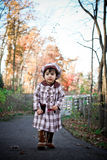 Walk in fall. Two year old walking on a path with beautiful fall colors in the background Royalty Free Stock Image