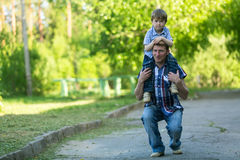 Walk father and young son. Love in the family. Royalty Free Stock Photography