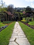 Walk in the garden. Pathway in a marvelous garden reach of flowers and trees. Lago Maggiore, Italy Stock Photo
