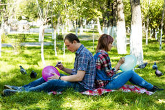 Walk in garden. Young men and women draw on air ball Stock Image