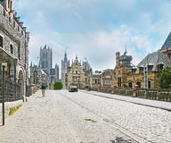 Walk in Ghent. The St Michael`s street leads to the main city landmarks along the the same named bridge and Sint-Michielskerk, stepped gable mansions and across royalty free stock images