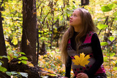 Walk in golden autumn forest expectant mother Stock Images