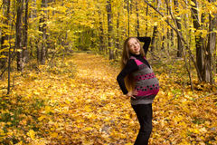 Walk in golden autumn forest expectant mother Stock Photography