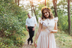 Walk a happy young couple on the nature royalty free stock photography