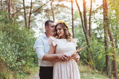 Walk a happy young couple on the nature royalty free stock photos