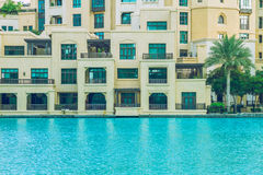 Walk in the heart of Dubai. We can see the street, buildings and Royalty Free Stock Photography