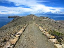 Walk to Heaven. Long rocky walking track on the island of the sun at 4000m altitude appears to be close to heaven Royalty Free Stock Image