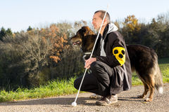 Walk with his guide dog. A blind man on a walk with his assistance dog Stock Photography