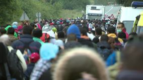 Walk in the hope of a right life-European refuges crisis stock video footage