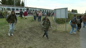 Walk in the hope of a right life-European refuges crisis stock video