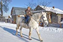 Walk on a horse. The girl goes astride a horse Royalty Free Stock Images