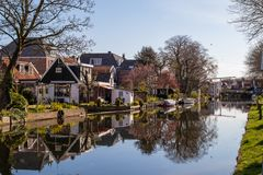 Walk through edam , Holland. Walk through the houses of villages under the sea. There are a lot of relexes in Edam royalty free stock image