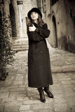 Walk in Jaffa. Girl with black coat walk in Jaffa Stock Image