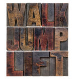 Walk, jump, lift in wood type Stock Image