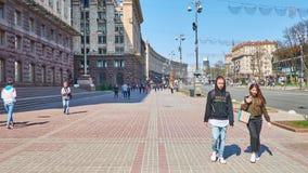 Walk in Kiev city center, Ukraine. KIEV, UKRAINE - APRIL 14, 2018: Walk along Khreshchatyk Avenue - the central city street, with a view on buildings of the stock footage