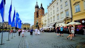 Walk in Krakow city center, Poland. KRAKOW, POLAND - JUNE 10, 2018: The Main Square stock video footage