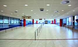 Walk with ladder grab in empty hall inside airport. Walk with ladder grab in empty light hall inside airport at day Stock Images