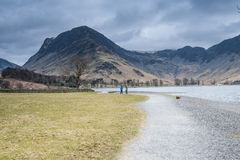 A walk in the lakes. Ramblers walking in the Lake District stock photos