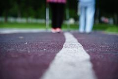 Walk lane in the park, close take, with senior pedestrians royalty free stock photography