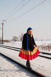 Walk in the line. Pretty girl is walking on the rail Stock Image
