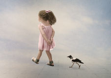 The walk. The little girl and the little crow on the walk Royalty Free Stock Photography