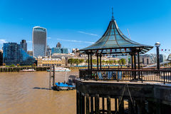 Walk at London Bridge Pier from the south bank of thamse river. With Pavillon in front and embankment with skyscrapers in the back stock photography