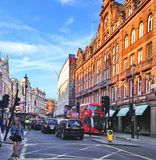 Walk in a london street. A picture of a walk in a london street near the leiecester square,of traffic and buildings,in a summer day Stock Image