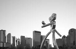 The walk man and skyline of Dallas. The walk man traveling at city Dallas, TX USA. It is a black and white picture Royalty Free Stock Photos