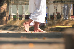 Walk for meditation. The person in white cloth is walking slowly to meditation Stock Images