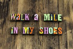 Walk mile shoes experience understanding compassion learn. Letterpress letters learning insight kindness helping nice kind life journey run follow lead stock photos
