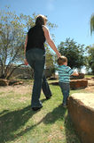 Walk with mom royalty free stock images
