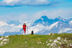 A walk in the mountains a woman with her dog friend Stock Image
