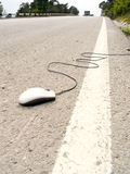 Walk of the mouse. The computer mouse lays on an automobile line Stock Photo